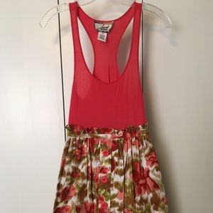 Fun coral dress with beautiful designed skirt